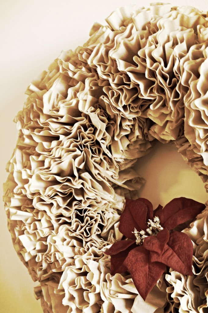 {a thrifted wreath covered with a coffee filter (or two), served with a side of hot glue gun burns..}