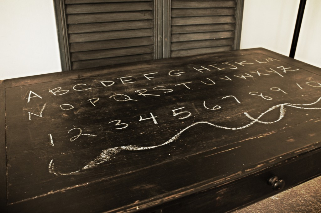 {a few coats of black spray paint to a hand-me-down pine coffee table make a perfect chalk and coloring table for a certain 2-year-old little boy}